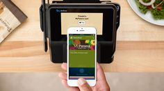 Hold iPhone up to the reader and Apple Pay automatically selects the right reward card.