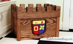 This is a toy boy - disguised as a castle!  The perfect place for kids to put treasured toys.  Post includes DIY tutorial.
