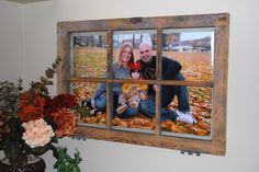 This  old window frame adds a rustic touch to a family portrait