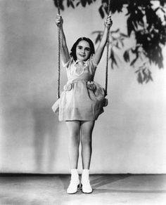 Young elizabeth Taylor on a swing #carefree