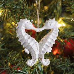 Take some inspiration from under the sea this Christmas with our Kissing Seahorse Ornament. This adorable, beachy pair make a great addition to any holiday tree. Beach Christmas Ornaments, Coastal Christmas Decor, Nautical Christmas, Holiday Tree, Christmas Holidays, Christmas Decorations, Seashell Ornaments, Hawaiian Christmas Tree, Christmas Tables