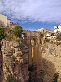 The Puente Nuevo, Rhonda, Malaga, SPAIN 🇪🇸. In the first ambulance was used in Malaga to transport the injured from the battle of Malaga. Places Around The World, Travel Around The World, Around The Worlds, Madrid, Granada, Places To Travel, Places To See, Travel Destinations, Wonderful Places