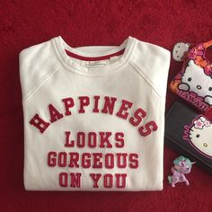 "🎉HP🎉 Happiness sweatshirt (one last SMALL left) L.O.G.G. label by H&M ""HAPPINESS LOOKS GORGEOUS ON YOU"" in red embroidered letterman print crew neck with front pocket white sweatshirt, material 60% cotton 40% polyester. 2 sizes available: Small & Medium. Measurements laying flat: (across) armpit to armpit and (length/slight high low) shoulder to hem: (small) about 22"" across and 24.5"" front 27"" in back length; (medium) about 24"" across and 26"" in front 28"" in back length. H&M Tops…"