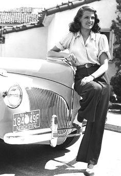 Rita Hayworth, 1940s, wide-leg pants, a western belt and rolled-short-sleeve shirt
