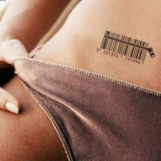 Realistic dark black ink bar code with zipper tattoo on lady's pubic area