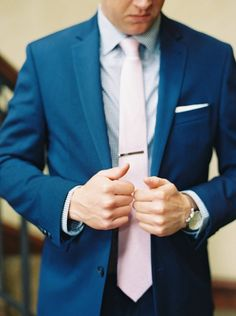 Southern Gentleman in a bright blue suit, navy gingham shirt, and light pink tie with a custom patterned pocket square | Groom Getting Ready Photos | Simply Jessica Marie's…