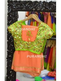 Peach pure georgette saree paired up with mirror work blouse