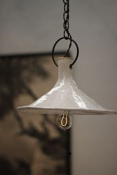 A Funnel Ceramic Lamp by Natalie Page via BDDW I Remodelista #PinToWin #Anthropologie