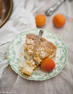 Crumb Apricot Cheesecake- Apricot Cheesecake encased in a buttery crust with almond crumb topping.