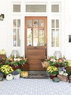 Rustic lanterns surrounded by fresh greens, pumpkins, rust and gold potted mums and potted cabbage. Veranda Design, Front Porch Design, Rustic Lanterns, Decoration Inspiration, Decor Ideas, Farmhouse Front, Modern Farmhouse, Farmhouse Ideas, Farmhouse Style