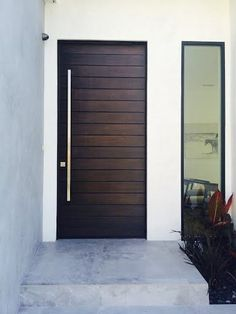 A multi-horizontal plank door from ETO Doors with side lite. Who wouldn't want to walk through this door every day?
