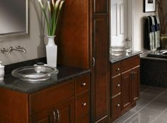 CliqStudios' Carlton kitchen cabinets in the Cherry Russet finish were perfect for this bathroom's vanity with his-and-hers sinks.