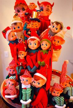 Vintage knee-hugging elves. I didn't realize they were around before the Elf on the Shelf story!