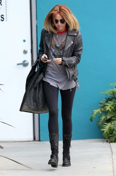 Miley Cyrus leaves Windsor Pilates in Los Angeles after taking a class. She looked like a rock star in black leggings, leather boots, and a leather jacket.