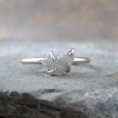 Raw uncut diamond engagement ring, I couldnt love this more!!! Or a saphire or amethist. SO BEAUTIFUL!!!