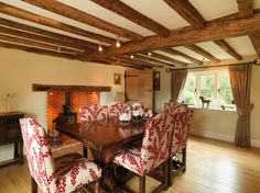 Beguiling Oak Beams home interior design Farmhouse Dining Room South East home insurance 17th Century bespoke kitchen English country Inglenook fireplace Lighting design limestone floors listed oak beams oak floors thatch Thatched Cottage traditional - Decorcology.com