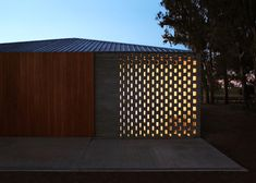 """Standard patterned concrete blocks have been """"backlit"""" here.   Clever way to improve night curb appeal."""