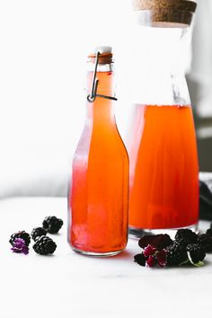 This homemade fruit kvass with berries, lime, and mint is a gluten free version of a popular Russian fermented probiotic drink. This fermented fruit recipe makes a refreshing, tangy, bubbly drink that you can make right at home. Easy Drink Recipes, Mint Recipes, Fruit Recipes, Fermented Fruit Recipe, Fermented Foods, Fruit Drinks, Healthy Drinks, Beverages, Beet Kvass