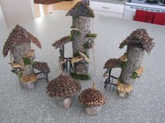 Cute little fairy houses - these are made from a small branch bark-on and pine cone scales for the roof - the little bump outs are adorable and the doors look like they are perfectly fitted - more posts: http://fanciliciousfairylands.blogspot.com/2011/02/woodland-fairy-house.html  http://fanciliciousfairylands.blogspot.com/2011/02/welcome-to-woodland-fairy-village.html ********************************************   Fancilicious Fairylands - #fairy #garden #miniature #woodland #house #houses…