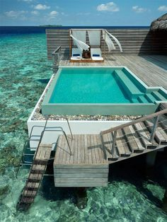 Dusit Thani Maldives ~ Dusit Thani Maldives blends graceful Thai hospitality with the unparalleled luxury setting of the beautiful Maldives. Encircled by white sandy beaches, a rich house reef and turquoise lagoon, the resort on Mudhdhoo Island hosts 100 villas and residences.