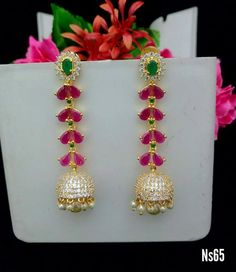 Beautiful one gram gold jumkhi with leaf design strings. Jumkhi studded with white pink and green color stones. Gold Jhumka Earrings, Jewelry Design Earrings, Gold Earrings Designs, 1 Gram Gold Jewellery, Gold Rings Jewelry, Bridal Jewelry, Handmade Jewellery, Gold Earrings For Kids, Silver Pooja Items