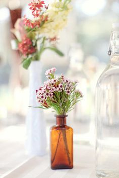 wax flower also for center piece small bottles
