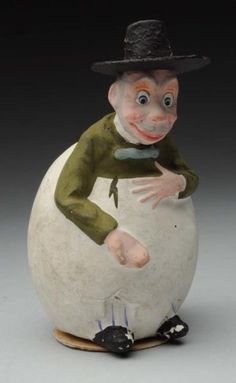 Lot # : 1253 - Man in Egg Candy Container.