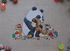 Panda & Boy, fabulous stitching and detail, I think fun to do.
