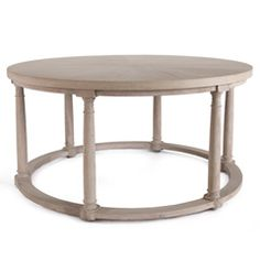 """Simple yet distinctive, the Bliss Studio Delians coffee table marries architectural design with smooth style. This round furnishing showcases six columnar legs on an open, circular base. 35.25"""" Diameter x 17.5""""H. Wipe down with soft, dry cloth to clean."""
