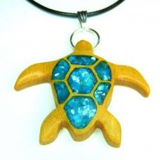 For our partnership with Sea Turtle Conservancy, we have created a special line of handmade turtle-themed items. For every sale of an item from the Sea Turtle collection, 20% will be donated directly to STC.  This sea turtle pendant is handmade from Yellowheart wood. The inlay is blue-coloured crushed shell. Yellowheart is a bright and vibrant yellow-coloured wood from Brazil.