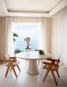 A Roman torso, a table conceived by Boris Vervoordt, and Pierre Jeanneret chairs at a Côte d'Azur villa.