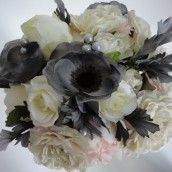 Grey appears to be a popular colour for bridesmaids dresses next year.  Looks great with our new bridal bouquet with grey anemones and beaded grey pearls. Grey & Ivory Silk Wedding Bouquet.  By adding a touch of pink bridesmaids bouquets could be pink peonies.  Beautiful.