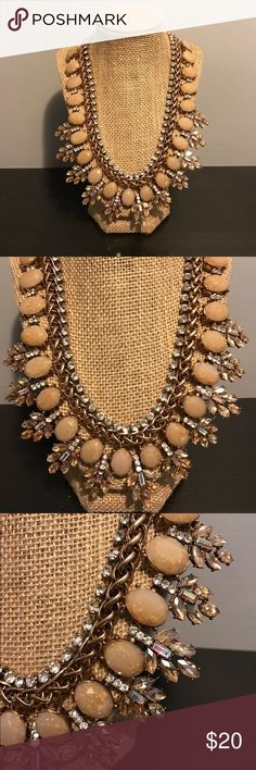 Aldo Bib Necklace Aldo Bib Necklace. Gold with mixed stones. New with tags. A great statement piece! Aldo Jewelry Necklaces