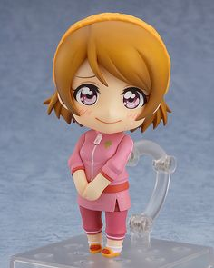 "**""Hey everyone! The rice is ready!♪""**  From the popular anime series 'LoveLive!' comes a Nendoroid of Hanayo Koizumi wearing her training outfit! She comes with two expressions including a gentle smiling expression as well as a more serious expression that suits her diligent personality perfectly!  Optional parts include a rice cooker and rice scoop to show her love for rice, as well as glasses parts which she can wear! A special 'holding hands' hand part is also included for use with the…"