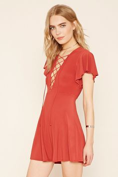 Forever 21 Contemporary - A knit A-line dress with flounced cap sleeves and a lace-up neckline.