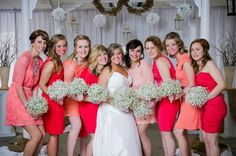 Coral bridesmaids dresses and baby's breath bouquets