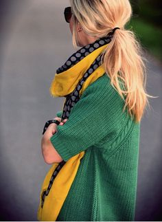 Green sweater and beautiful yellow accented scrarf.