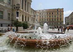 The charms of Aix-en-Provence in early summer.  Place du Palais de Justice (Image by: Ian Britton FreeFoto.com)