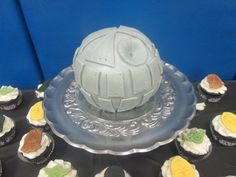 Death Star cake with star wars cupcakes
