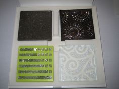 The Kitchen Backsplash Features Chrome Bars Inset With