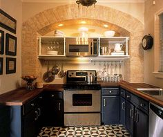 Kitchen with Faux Brick Arch (made using DuRock Spacco plaster) - Black Cabinets - Debbie Travis' Facelift:  Glenn's Kitchen