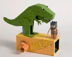 Moving dinosaur craft. Turn handle and Dino bends down and eats man. Neat idea.