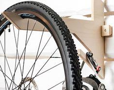 Handmade Plywood Bicycle rack/wall mounted hook for bike | Etsy Hanging Bike Rack, Wood Bike Rack, Bicycle Hanger, Bike Hooks, Bicycle Decor, Indoor Bike Storage, Bicycle Storage, Vertical Bike Stand, Vertical Bike Storage