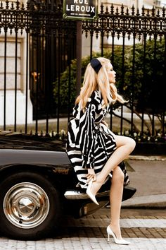 Claudia Schiffer.. I wish I could look this chic while adjusting my shoe. I also wish I could be in Paris.