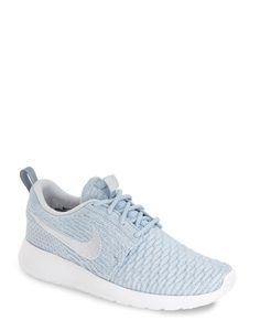 Looking sporty-chic in these dreamy pastel blue Nike sneakers.