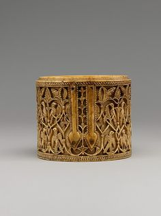 Cylindrical Box (Pyxis)  Object Name: Box Reign: al-Hakam II (961–76)   Date: 10th century Geography: Spain   Medium: Ivory; carved   Dimensions: H. 2 5/8 in. (6.7 cm) Diam. 3 1/4 in. (8.3 cm)