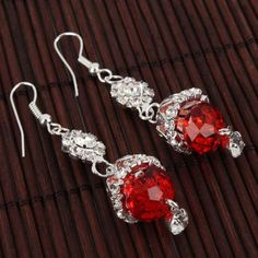 Wearing these earrings you will be the most beautiful lady  http://ornahouse.ecrater.com/p/14860643/elegant-silver-plated-red-stone#