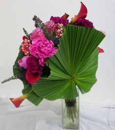 A palm fan filled with flowers. Eye candy. For flowers to Mumbai www.spring-blossoms.com