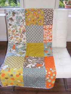 Handmade patchwork lap/cot quilt made with Moda Sanae fabric.. £60.00, via Etsy.