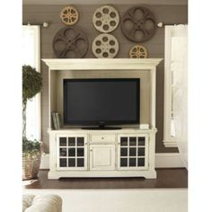 T think I can turn my media center into one close to this one... Ballard Designs Media Console & Hutch/Black - Check Ana White blog